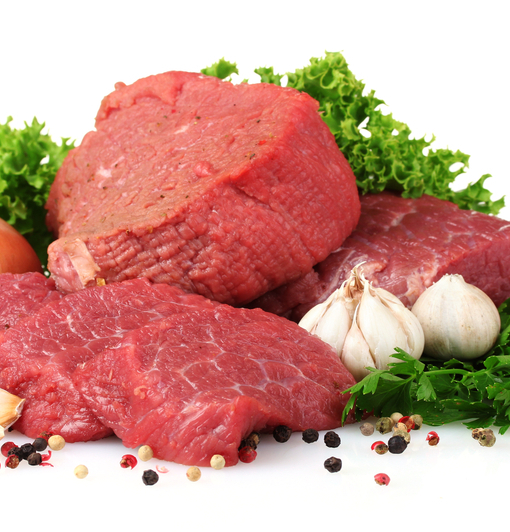 raw meat, vegetables and spices isolated on white